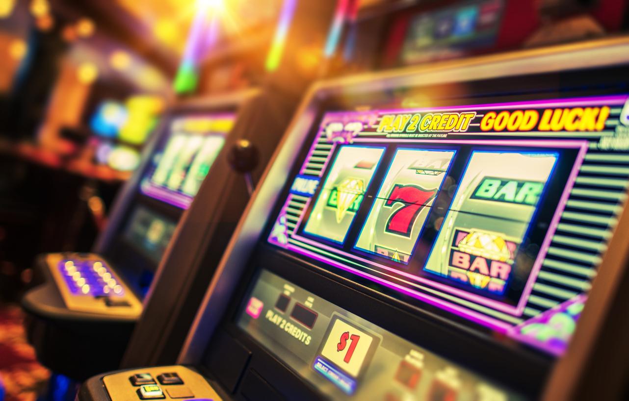 Casino Interior and Row of Classic Slot Machines. Las Vegas Gambling Theme